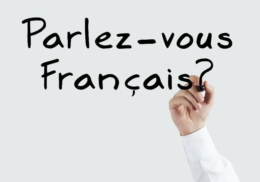 Man writing Parlez-vous français