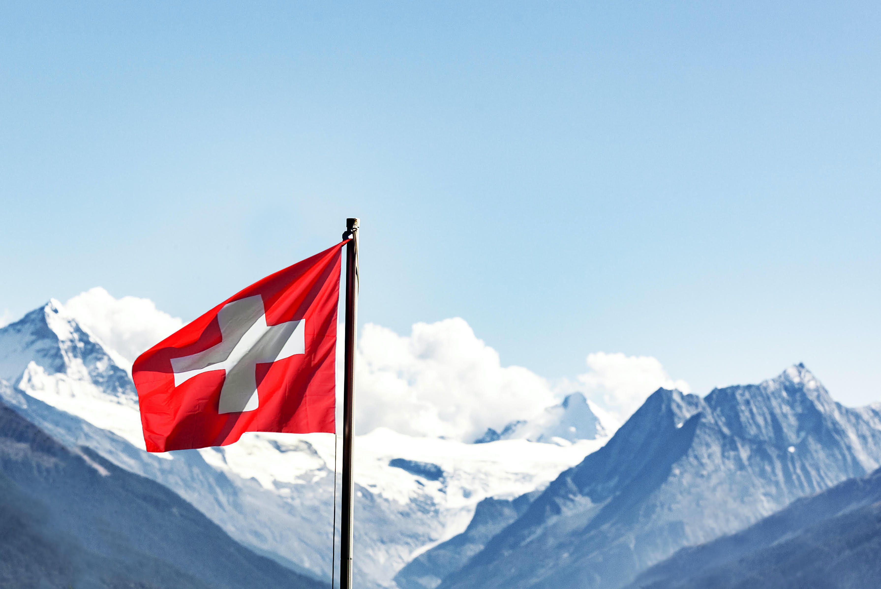 scenic mountains with Swiss flag